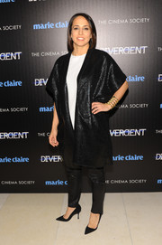 Anne Fulenwide went for exotic elegance in a kimono-inspired black coat during the 'Divergent' screening in NYC.