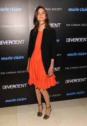 An oversized black blazer added a masculine touch to Anouck Lepere's flirty orange dress during the 'Divergent' screening in NYC.