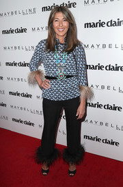 Nina Garcia hit the Marie Claire Fresh Faces celebration wearing a geometric-print, feather-cuff top by Prada.