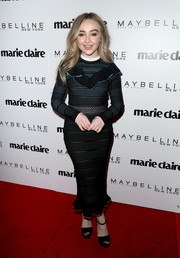 Sabrina Carpenter covered up in a form-fitting Versace sweater dress with a ruffled yoke for the Marie Claire Fresh Faces celebration.