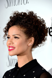 Gugu Mbatha-Raw accessorized with a trendy ear cuff at the Marie Claire Fresh Faces party.