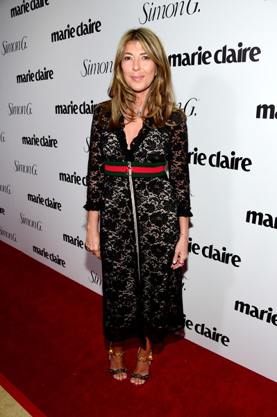 Nina Garcia made a chic appearance at the Marie Claire Fresh Faces party in a black zip-front lace dress by Gucci.