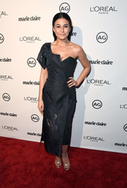 Emmanuelle Chriqui sealed off her fab outfit with strappy gold heels.