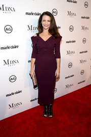 Kristin Davis amped up the edge factor with a pair of open-toe lace boots.