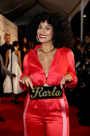 Tracee Ellis Ross showed off her Edie Parker 'Karla' clutch while posing on the Image Makers Awards red carpet.