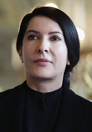 Marina Abramovic achieved a soft polished look with her loose ponytail.