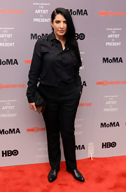 Marina Abramovic went for an all-black menswear-inspired look with her studded black button-down and slacks.