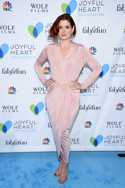 Debra Messing kept it classy in a long-sleeve pink wrap dress at the Joyful Revolution Gala.