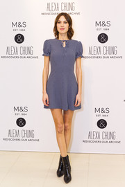 Alexa Chung's pointy black ankle boots provided an edgy contrast to her cute frock.