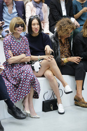 Eva Chen kept it comfy with a pair of white loafers at the Marni fashion show.