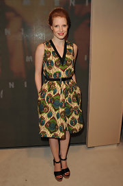 Jessica accessorized her printed frock with black platform sandals.