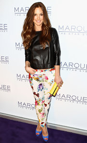 Minka Kelly paired this loose leather blouse with her floral pants in Sydney.