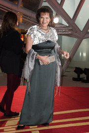 Claudia Cardinale chose a gray evening dress with a sequined neckline for the Marrakech International Film Festival opening ceremony.