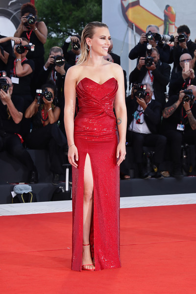 Scarlett Johansson glammed up in a strapless red sequined gown by Celine for the Venice Film Festival screening of 'Marriage Story.'