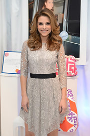 Maria Menounos kept her look fun and flirty with this gray lace cocktail dress with black belt.