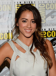 Chloe Bennet's loose fishtail braid showed off her chic chestnut highlights.