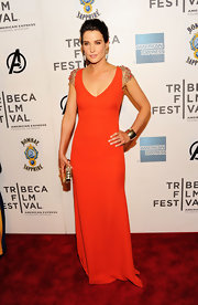 Cobie Smulders looked breathtaking at the Tribeca Film Festival in this orange gown with beaded warrior shoulders.