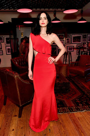 Krysten Ritter went for flirty glamour in a red Cushnie et Ochs one-shoulder gown with a side cutout at the 'Defenders' premiere after-party.