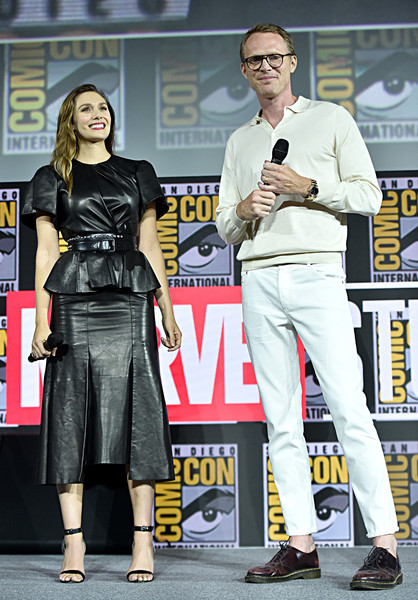 Elizabeth Olsen matched her top with a black leather midi skirt, also by Alexander McQueen.