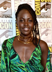 Lupita Nyong'o jazzed up her look with a layered gold necklace.