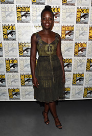 Lupita Nyong'o donned a green Givenchy print dress with buckled shoulder straps and a sheer-overlay skirt for the Marvel Studios panel during Comic-Con.
