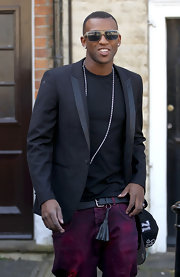Oritse Williams dark gray blazer added a classic touch to his hip hop attire.