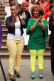 Erica Atkins-Campbell stepped out in a vibrant ensemble that featured bright blue and green sandals.