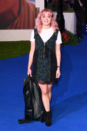 Maisie Williams layered a printed pinafore dress over a white T-shirt for the European premiere of 'Mary Poppins Returns.'