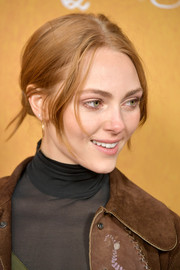 AnnaSophia Robb sported a mildly messy center-parted updo at the New York premiere of 'Mary Queen of Scots.'