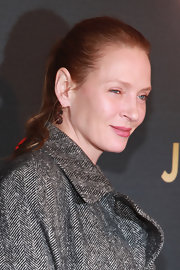 Uma Thurman went for minimal styling with this simple ponytail during Justin Timberlake's concert.