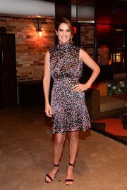 Cobie Smulders looked vibrant in a color-speckled dress with a cinched-in waist during Mastercard's Masterpass campaign launch.