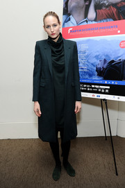 Leelee Sobieski went for sleek styling with this structured navy wool coat at the opening night screening of 'Camouflage.'