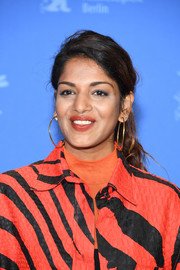 M.I.A. blinged up with a pair of oversized gold hoops.