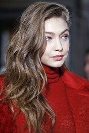 Gigi Hadid looked gorgeous with her richly textured waves at the Max Mara fashion show.