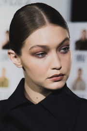 Gigi Hadid sported a sleek center-parted ponytail at the Max Mara Spring 2019 show.