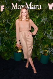 Jaime King continued the neutral motif with a tan croc-embossed clutch.