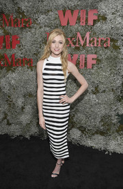 Katherine McNamara flaunted her slim physique in a black-and-white striped knit dress by Balmain at the InStyle Max Mara Women in Film celebration.