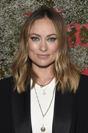 Olivia Wilde wore her hair just past her shoulders in a subtly wavy style at the 2019 Max Mara Face of the Future event.