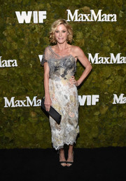 Julie Bowen was all about edgy glamour in a gauzy, multi-hued one-shoulder Marchesa dress during the Women in Film Face of the Future Award.