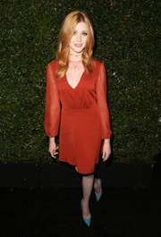Katherine McNamara kept it modest in a long-sleeve red cocktail dress by Alice + Olivia at the Max Mara Face of the Future event.