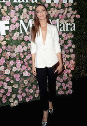 Angela Sarafyan flashed some cleavage in a plunging white blazer at the 2017 Face of the Future event.