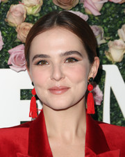 Zoey Deutch complemented her red suit with a pair of tassel earrings by Lizzie Fortunato.