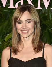 Suki Waterhouse looked subtly retro wearing this shoulder-length 'do with parted bangs and a teased crown at the Max Mara WIF Face of the Future event.