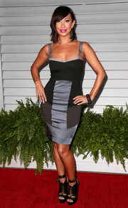 Cheryl Burke balanced out her sexy dress with a tough-chic pair of black lace-up platform sandals.