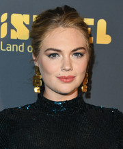 Kate Upton teamed her 'do with a pair of statement gold earrings.