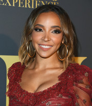 Tinashe wore her hair in shoulder-length waves at the Maxim Hot 100 Experience.