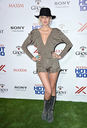 Caroline D'Amore rocked this long-sleeve nude-and-black striped romper with ruffled shorts and a deep V-neck for her super mod and cool look at Maxim's Hot 100 Party.