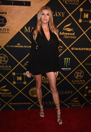 Charlotte McKinney flaunted her assets in a little black dress with a deep-V neckline during the Maxim Hot 100 Party.