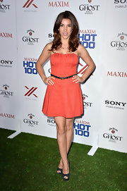 Adriana Costa's orange strapless dress gave her a fun pop of color at Maxim's Hot 100 Party.
