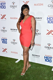 Omotola Jalade Ekeinde rocked a peach-colored bandage dress at the Maxim Hot 100 party.